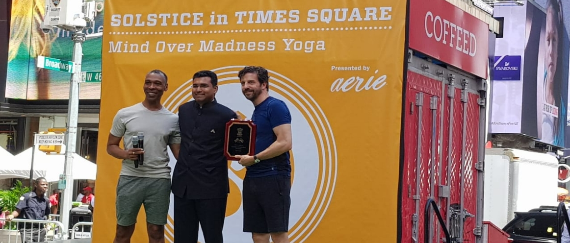 Solistice in Times Square on the International Day of Yoga, 2018. On the occasion, Mr. DP Misra, Consul, presented a plaque to Mr. Tim Tompkins, President of the Times Square Alliance