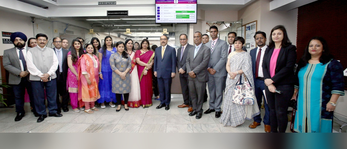 Amb. Harsh V. Shringla with the Consulate officials at the inauguration of New Queue Management System (QMS) in the Consulate